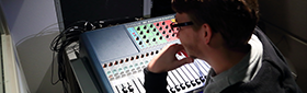 Student looks over a soundboard