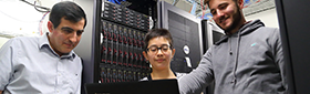 faculty and students work in the server room