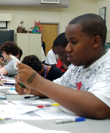 Students work on art at a table together