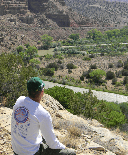 a students sits and admires the desert terrain