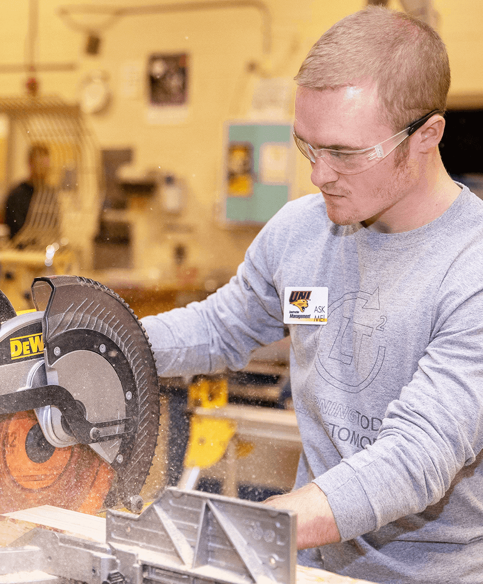 student using saw