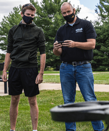 student and professor with drone