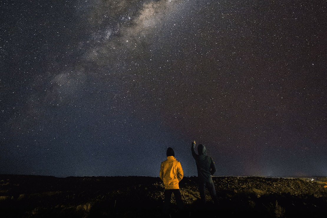 two people looking at the stars