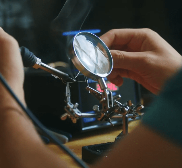 a close up of a student working on a piece of physics equipment